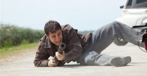 Joseph Gordon-Levitt as Joe with his special shotgun